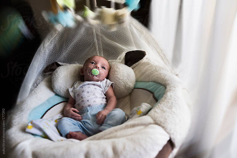 Newborn baby boy in a swinging crib by yuko hirao for Stocksy United