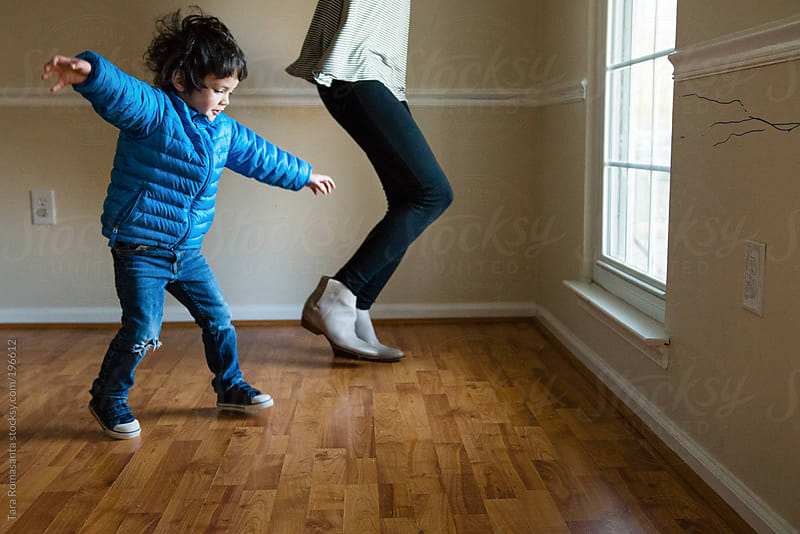 dance party with mom and child by Tara Romasanta for Stocksy United