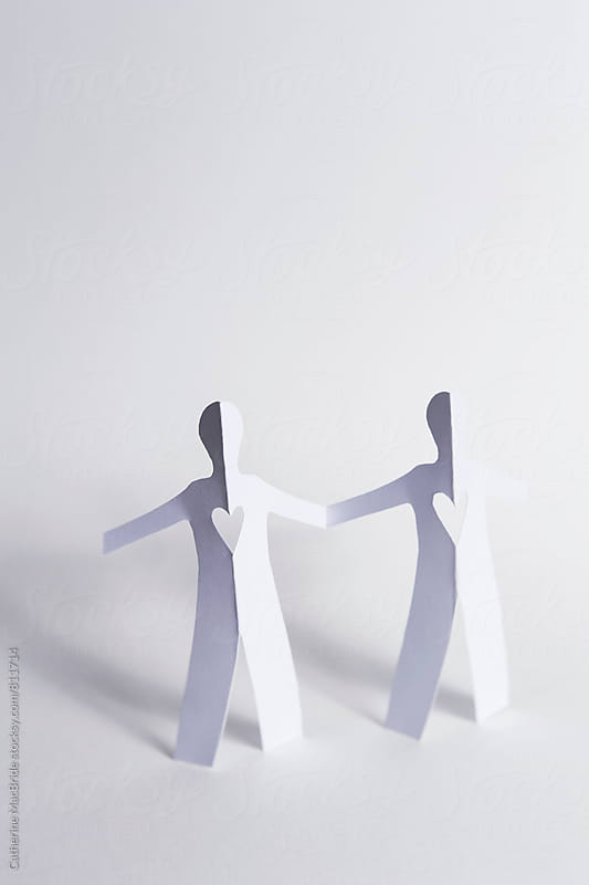 Two paper people... by Catherine MacBride for Stocksy United