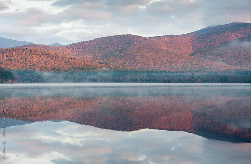 Fall foliage and mountain landscape beside lake by Matthew Spaulding for Stocksy United