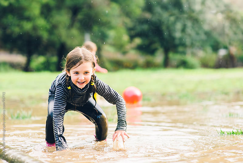 Little Girl Getting up after Falling in a Big Puddle by Gary Radler Photography for Stocksy United