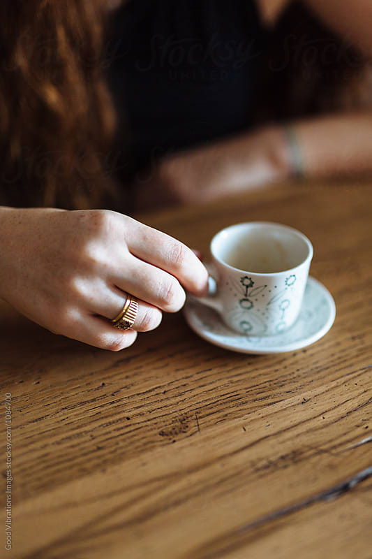 Woman drinking a coffee at home by Good Vibrations Images for Stocksy United