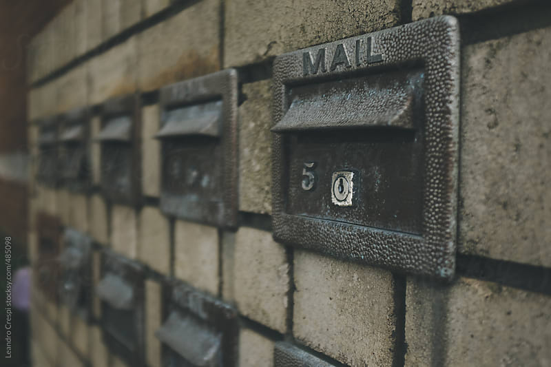 A wall of mailboxes by Leandro Crespi for Stocksy United