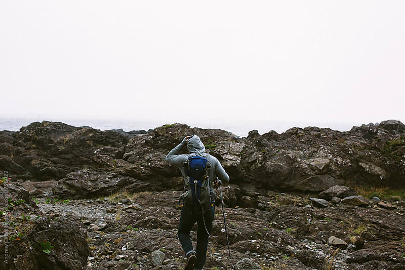 Man hiking rocky coastline - digital file by Andrew Cebulka for Stocksy United
