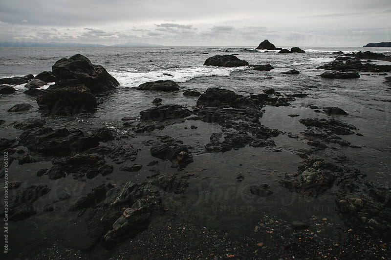Moody rocks and waves - west coast winter on the pacific ocean by Rob and Julia Campbell for Stocksy United