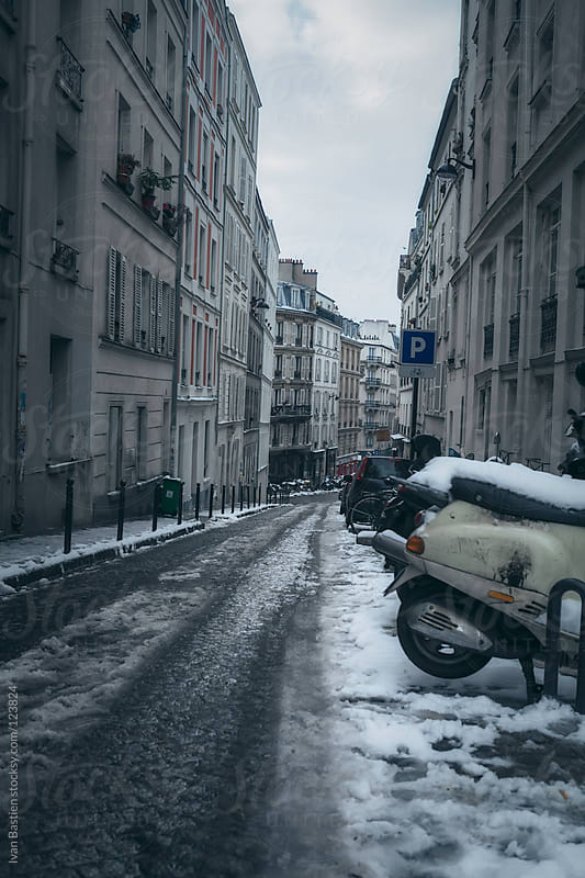 Street with snow on old pavement in Paris, France by Ivan Bastien for Stocksy United