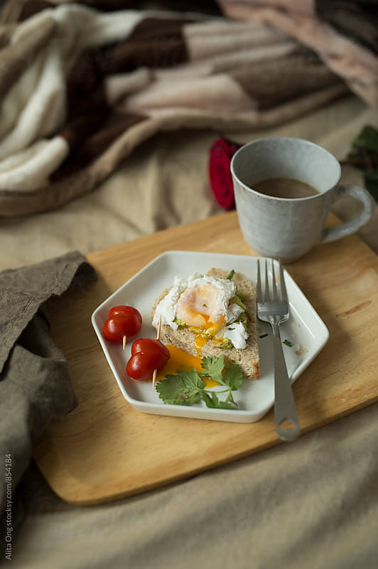 Heart-shaped breakfast in bed by Alita Ong for Stocksy United
