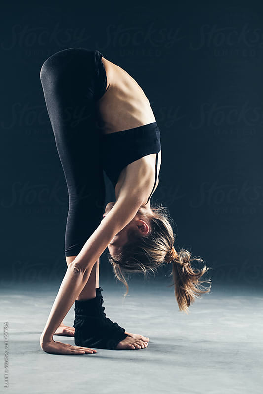 Woman Stretching by Lumina for Stocksy United