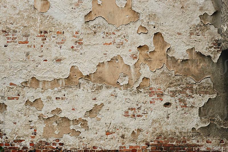 Pealing old brick wall by Atakan-Erkut Uzun for Stocksy United