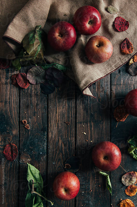 Apples on wooden table by Nataša Mandić for Stocksy United