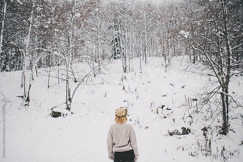 Standing in the snow by Bethany Olson for Stocksy United