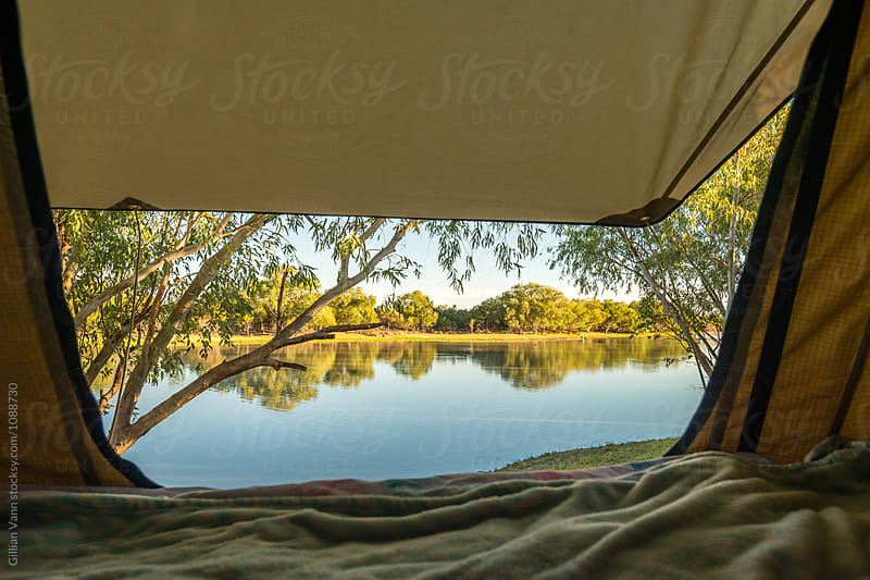 view from a tent overlooking a billabong in NT by Gillian Vann for Stocksy United