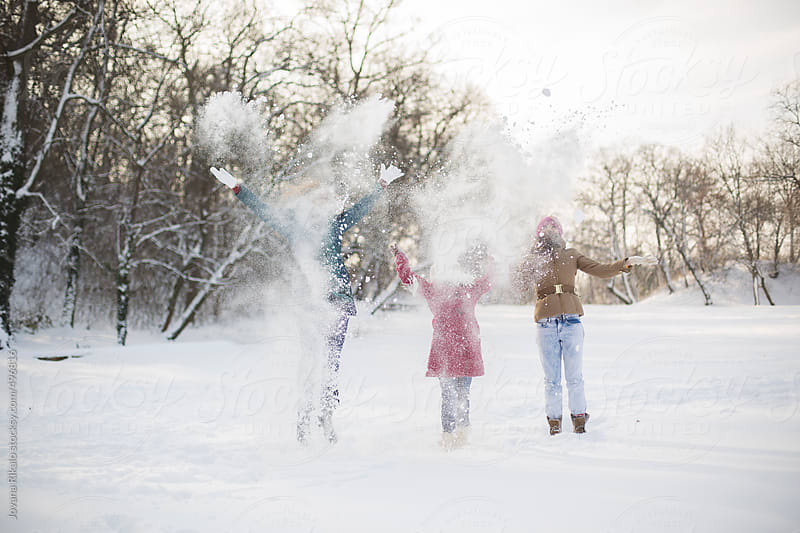 Sisters playing in the snow by Jovana Rikalo for Stocksy United