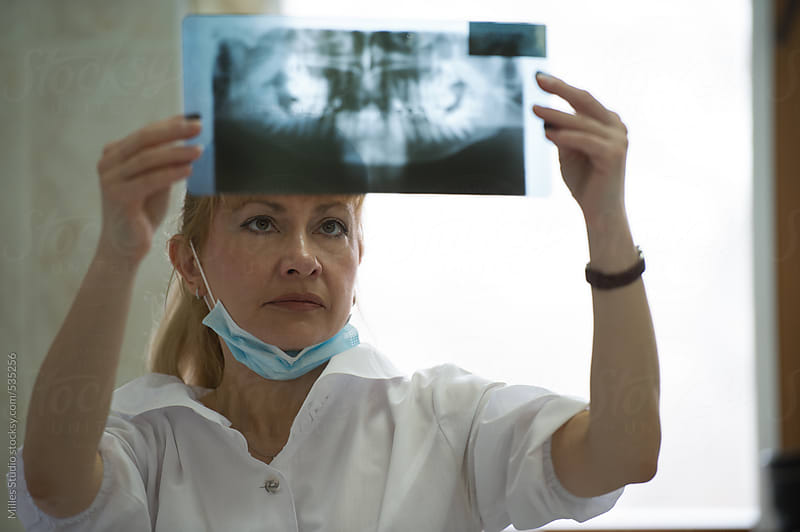 Dentist Examining a Radiography by Milles Studio for Stocksy United