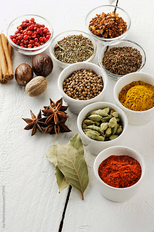 Food: Spices in bowls on a white table by Ina Peters for Stocksy United