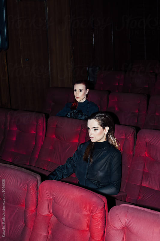 Two Female Models Sitting in a Cinema by Katarina Radovic for Stocksy United