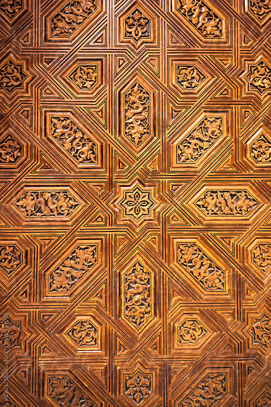 Arab details of a wooden door in a palace of Alhambra  by ACALU Studio for Stocksy United