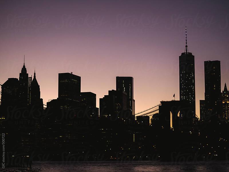Manhattan skyline at twilight by GIC for Stocksy United