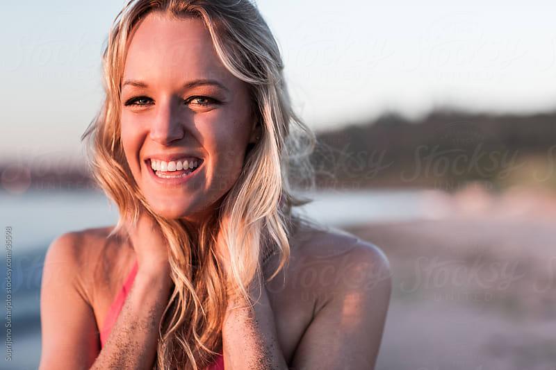 Happy beautiful woman in bikini on the beach  by Suprijono Suharjoto for Stocksy United