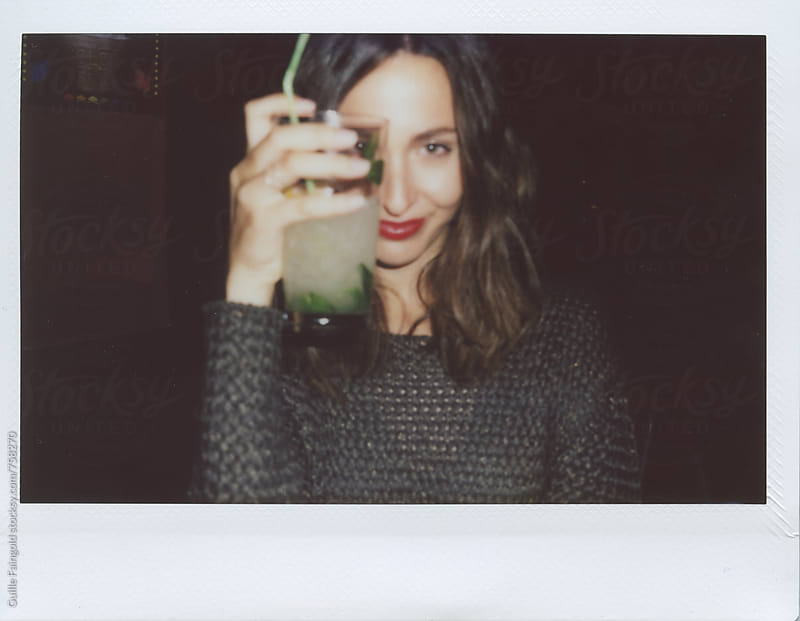young woman holding glass of soda by Guille Faingold for Stocksy United