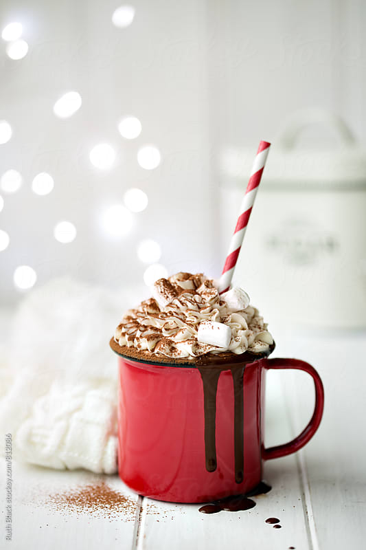 Hot chocolate with whipped cream and marshmallows by Ruth Black for Stocksy United