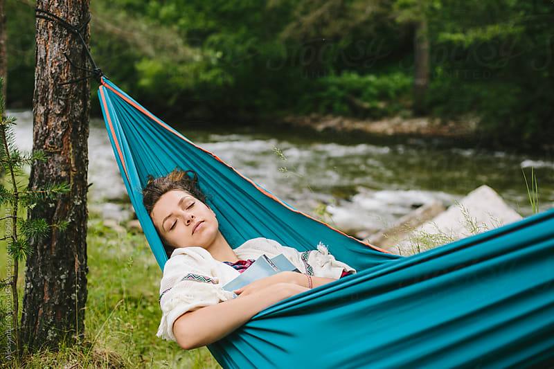 Young woman sleeping in hammock by Aleksandar Novoselski for Stocksy United