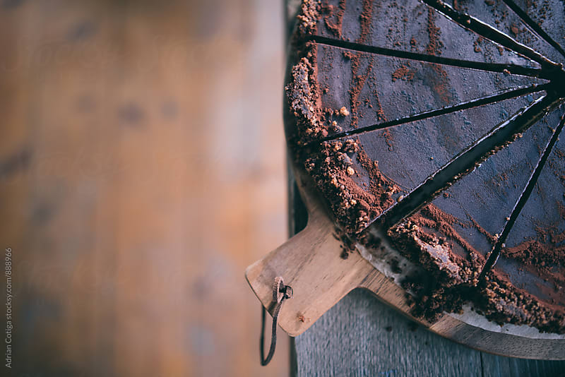 Sliced chocolate cake  by Adrian Cotiga for Stocksy United