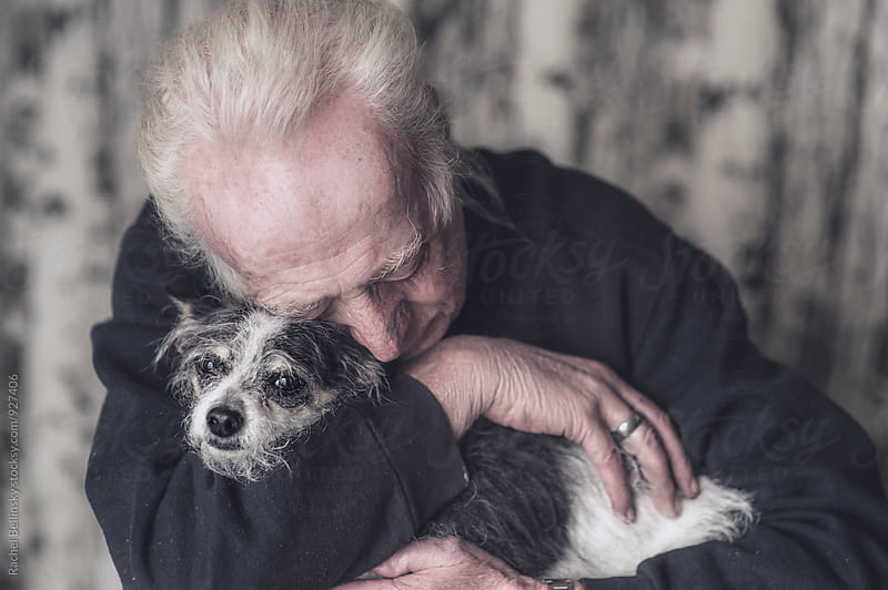 Touching portrait of an older man with his dog by Rachel Bellinsky for Stocksy United