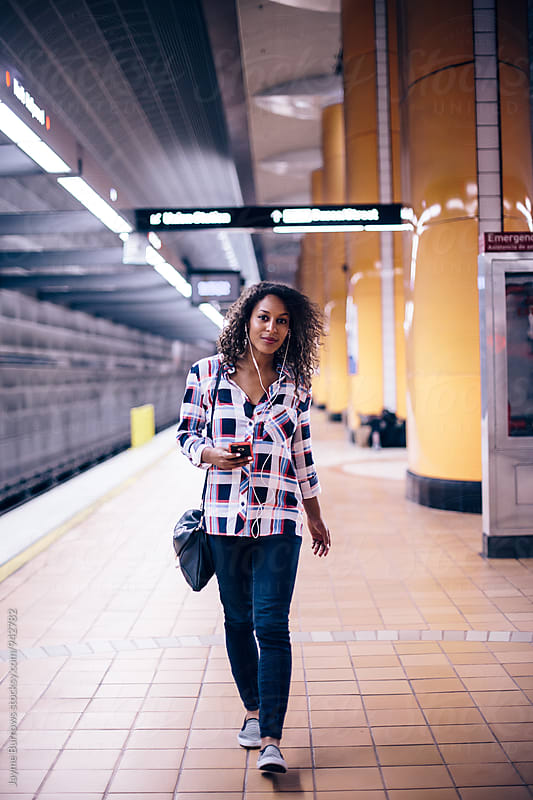 Adult Woman Walking on Subway Platform by Jayme Burrows for Stocksy United