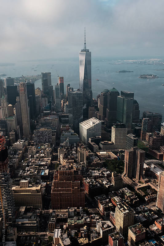 The lower Manhattan Skyline from the air. by Riley Joseph for Stocksy United