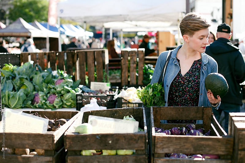 Woman shopping at farmers market by Jennifer Brister for Stocksy United