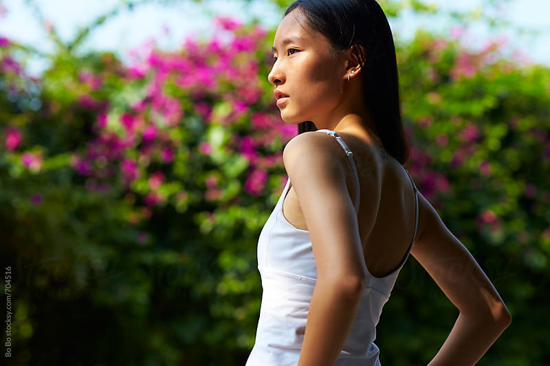 pretty young asian woman outdoor in summertime by Bo Bo for Stocksy United
