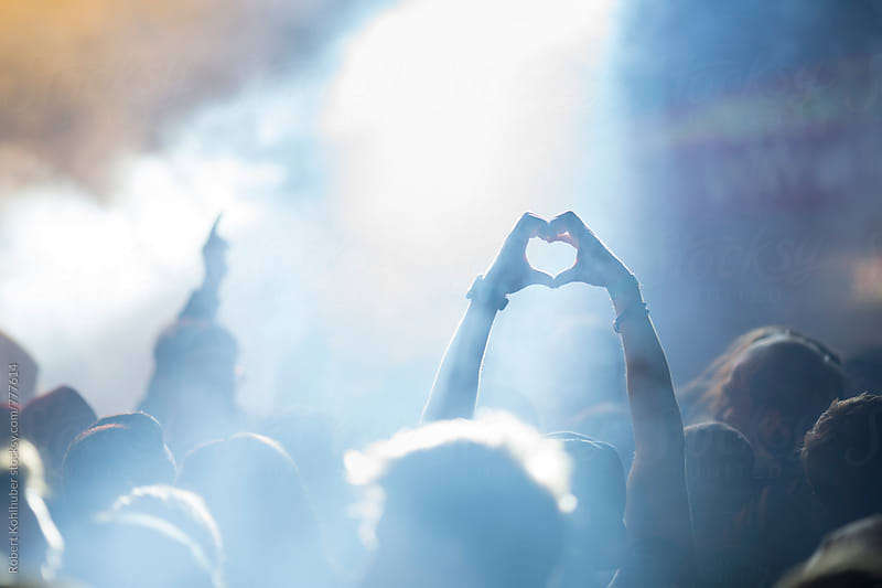 Fan forming heart with hands at live music concert, festival by Robert Kohlhuber for Stocksy United