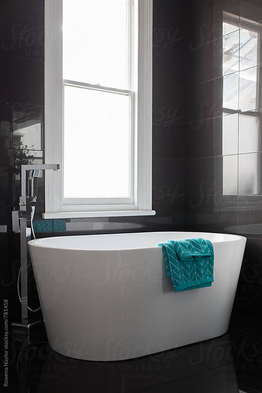 Modern bathroom design by Rowena Naylor for Stocksy United