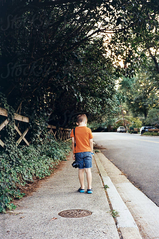 Young photographer exploring his neighborhood by Cameron Whitman for Stocksy United