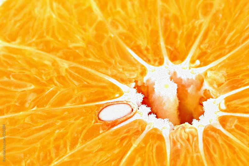 Orange slice closeup by Ilya for Stocksy United