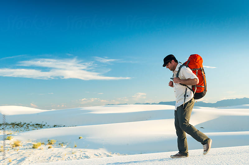 Man with Backpack in White Sands National Monument Hiking to Back Country Campsite by JP Danko for Stocksy United