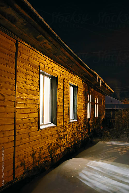 Village cottage at night by Danil Nevsky for Stocksy United