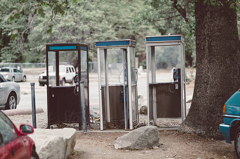three phone booths in park by Image Supply Co for Stocksy United