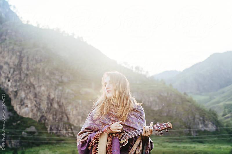Girl with ukulele by Artem Zhushman for Stocksy United