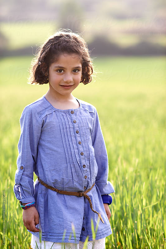Little girl outside at spring time by Guille Faingold for Stocksy United