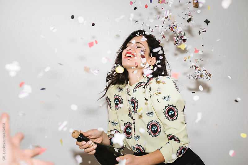 Woman with champagne at midnight countdown for the new year by GIC for Stocksy United