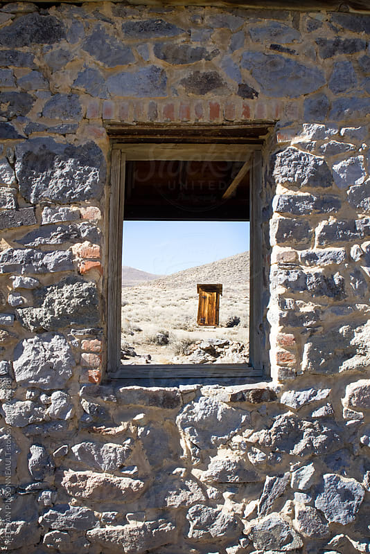 Peering Through Stone Window Frame of Ghost Town Building by MEGHAN PINSONNEAULT for Stocksy United