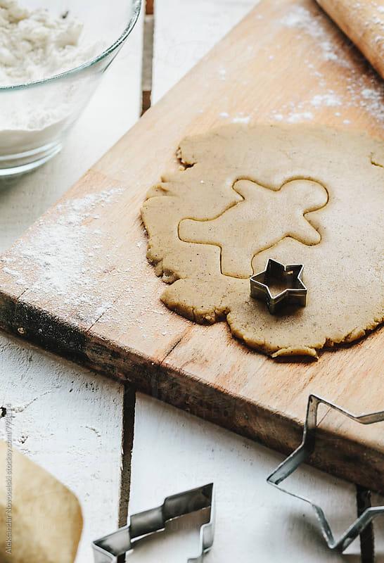 Preparing christmas cookies on white wooden table by Aleksandar Novoselski for Stocksy United