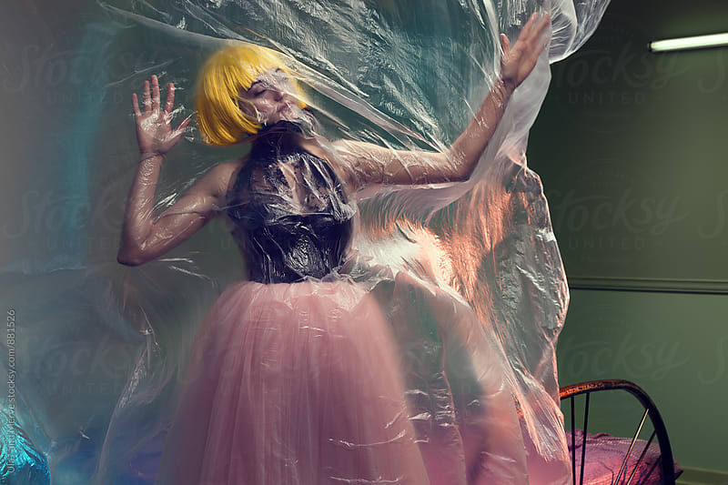 abstract image of a model with plastic sheeting by Ulaş and Merve for Stocksy United