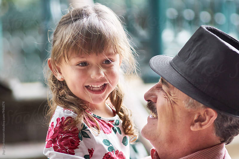 Close friendship between grandfather and granddaughter by Per Swantesson for Stocksy United