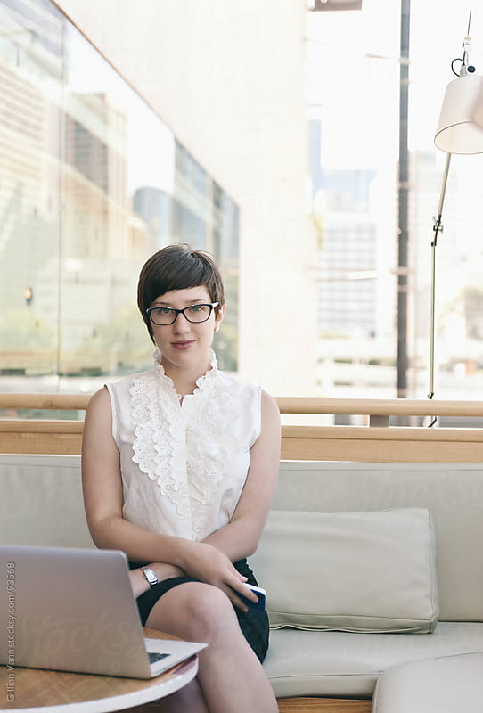 modern businesswoman in urban city office by Gillian Vann for Stocksy United