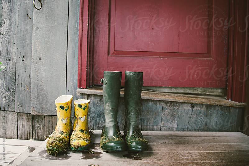 Grassy Rain Boots Sitting On A Doorstep by Laura Austin for Stocksy United