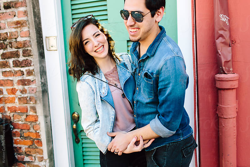Close up of a young smiling couple enjoying the outdoors  by Kristen Curette Hines for Stocksy United