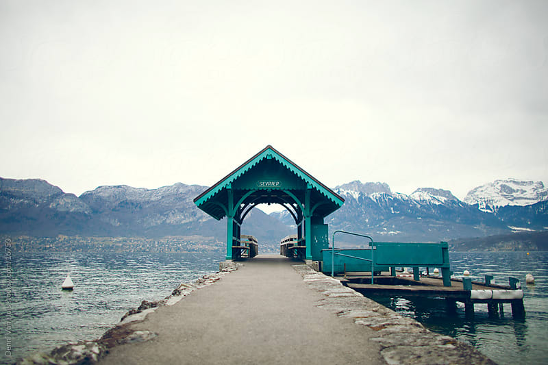 Empty pier on a lake betweens mountains by Denni Van Huis for Stocksy United